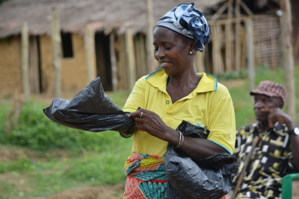 Community dwellers practicing how to use plastic bags as preventive tool